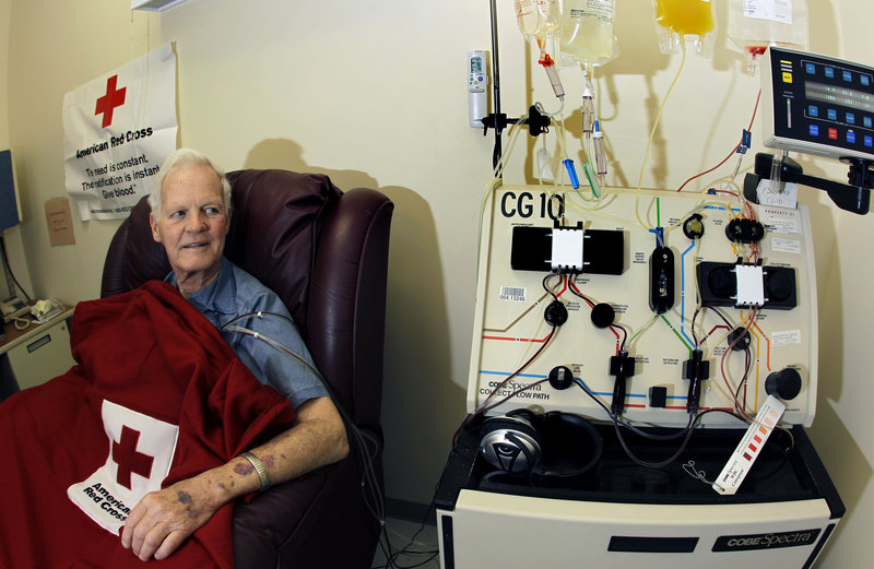 """Hooked up to a blood infusion machine at the Red Cross in Dedham, Mass., Bob Svensson undergoes the Provenge prostate cancer treatment. Svensson said he got the $93,000-a-year treatment because insurance paid. """"I would not spend that money"""" for Provenge, which adds four months' survival for men with incurable tumors, he said."""