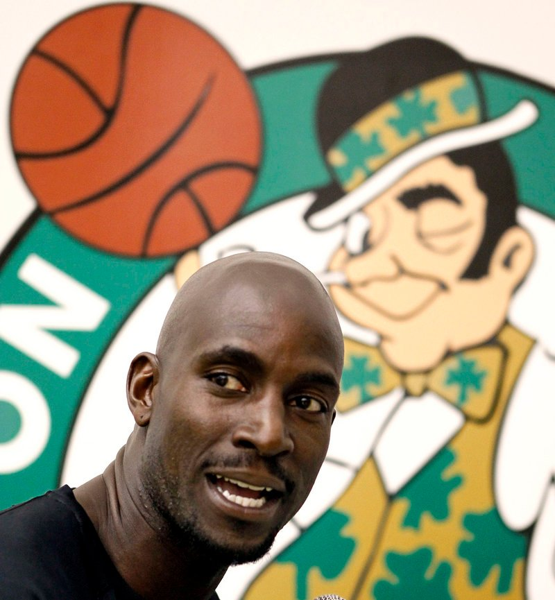 Kevin Garnett and the Boston Celtics open preseason training camp in Newport, R.I., today with the celebrity of Shaquille O'Neal spicing up the day-to-day routine. O'Neal says he's eager to fill a role, not star, with the team as he enters his 20th season.