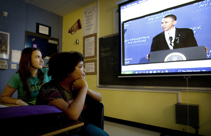 Eighth-graders Caitlin Anderson, left, 13, and Amani Alexander, 13, watch President Obama's speech to the nation's students earlier this month from their classroom at Fulmore Middle School in Austin, Texas. On Monday, Obama said many students are losing a lot of what they learn in school due to the length of summer vacation.