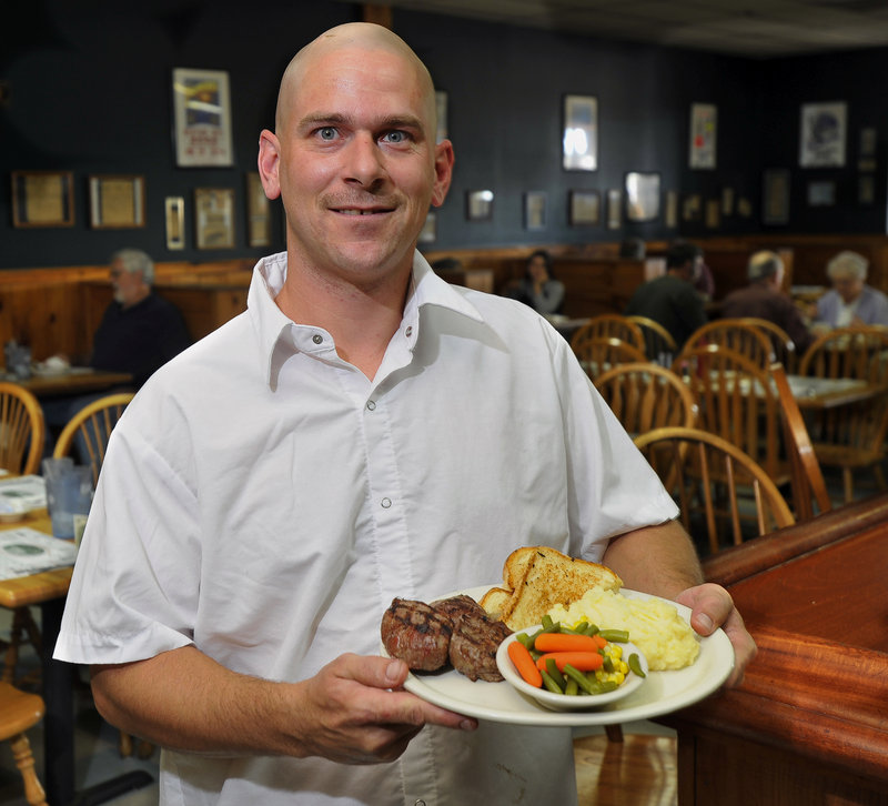 Carl Bernier, head chef at the Fairground Cafe, located at the Topsham Fair Mall, displays a specialty of the house: filet mignon medallions with potato, mixed vegetables and grilled Texas toast.