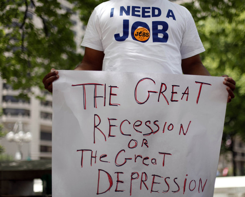 An unemployed man holds a sign at a rally organized in June of this year by the Philadelphia Unemployment Project in Philadelphia. The number of people in poverty rose in 31 states from 2008 through 2009 and no state showed a decline.
