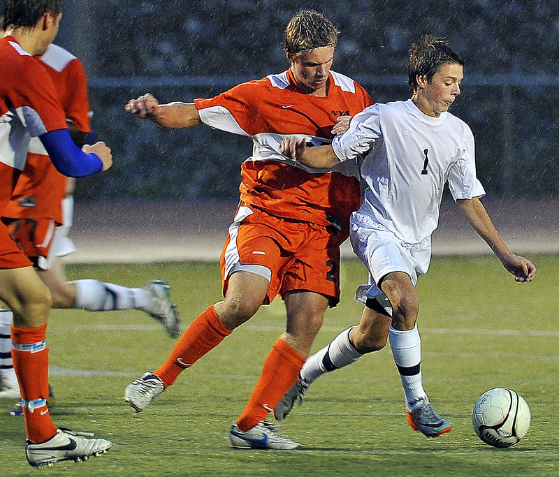 David Murphy of Yarmouth, right, keeps the ball from Michael Ianno of North Yarmouth Academy during their Western Maine Conference game Tuesday night. Yarmouth scored in the second half for a 1-0 victory.