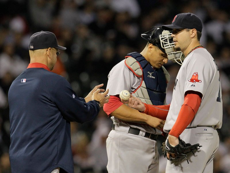 Josh Beckett of the Boston Red Sox hands the ball to Manager Terry Francona while being taken out in the seventh inning Wednesday night in a 5-2 loss to the Chicago White Sox.