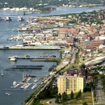 Aerial view of Portland waterfront with Portland House in foreground looking west to Casco Bay bridge.