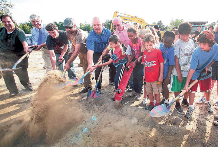 """Students from the Nathan Clifford After School Program join members of Portland's Skatepark Planning Committee at the groundbreaking Wednesday for the new facility at Dougherty Field. """"It means a lot to have a place like this,"""" said boarder Rocco DiDonato."""