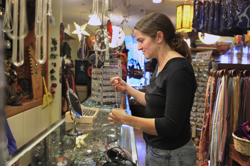 Lauren Ostis of Portland shops for a silver chain at the Mexicali Blues shop in Portland on Tuesday. The retail chain expects holiday sales to beat 2009.