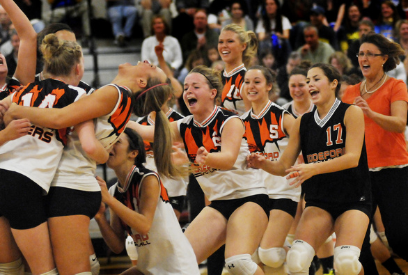 Staff Photo by Shawn Patrick Ouellette: Biddeford celebrates their State Class A volleyball championship over Falmouth Saturday, Oct. 30, 2010.