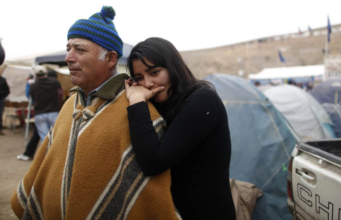 Carlos Galleguillos and Tabita Galleguillos, relatives of trapped miner Jorge Galleguillos, stand at the camp where relatives wait for news outside the San Jose mine near Copiapo, Chile, on Monday.