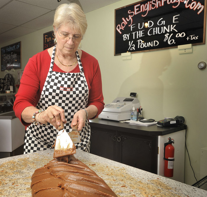 MaryBeth Munroe, owner of Roley's English Fudge and Gelato, in Kennebunkport. Monroe works a batch of fudge into a consistency for cutting into pieces at her shop recently.