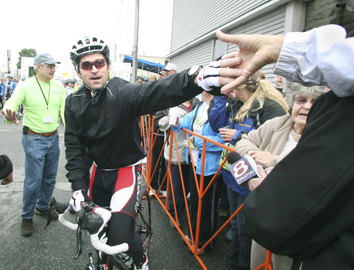 Maine native and actor Patrick Dempsey meets a fan before the start of last year's Dempsey Challenge in Lewiston.