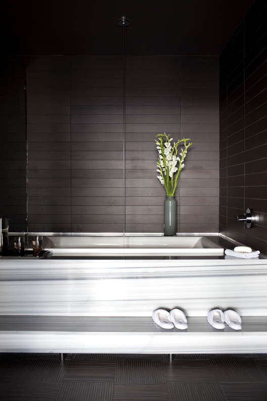 Designer Brian Flynn favors baths done in all white, black and white, or white with charcoal or black/brown.