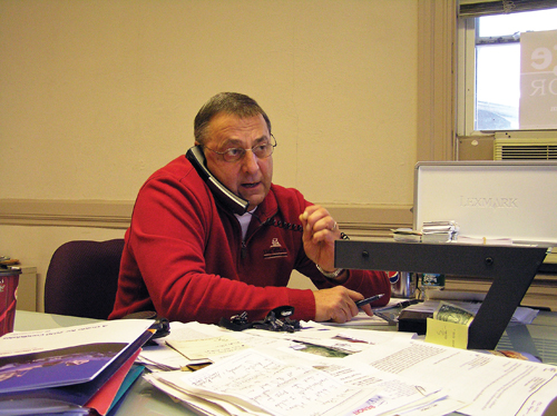 "REACHING OUT: Republican gubernatorial candidate Paul LePage speaks during a ""Tele-Town Hall"" call at his Waterville office on Saturday. LePage was able to reach many people at once with the calls, while answering questions and handling comments."