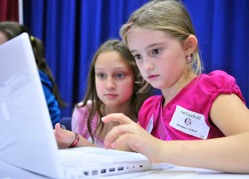"Clarissa Hemphill, left, and Kaley Norsworthy, both students at Fort Fairfield Elementary School, enter results from Maine's Student Mock Election 2010 into a computer during the ""Rally and Tally"" event Thursday afternoon at the Augusta Civic Center."
