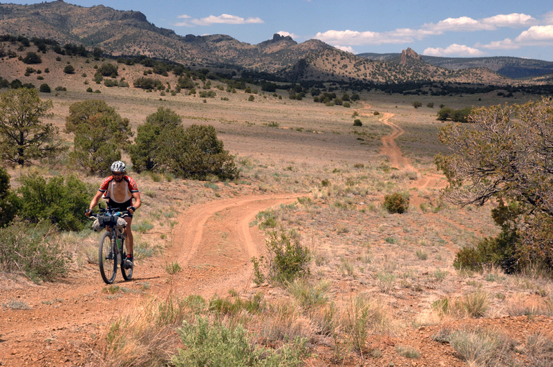 A racer pedals through the Rocky Mountains in