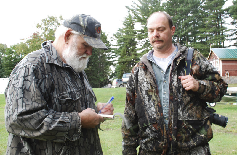 Bosowicz takes instructions from Keith Sochalsky on how the hunter from Union Township, N.J., wants the meat from the bear he shot to be butchered.
