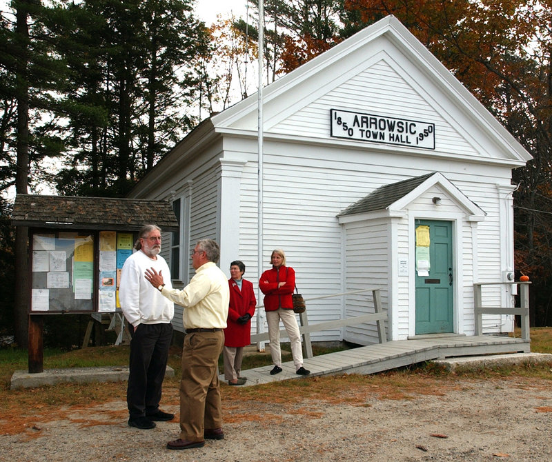 Voters discuss issues outside the Arrowsic Town Hall in 2004. Small towns can be sites for experimental programs that benefit other communities or the entire state, an analyst says.