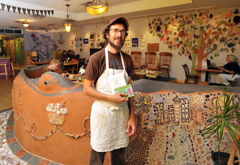 Jonah Fertig is one of three worker-owners at Local Sprouts Cafe on Congress Street in Portland, where the colorful, funky decor is one attraction and food prepared with panache is another.
