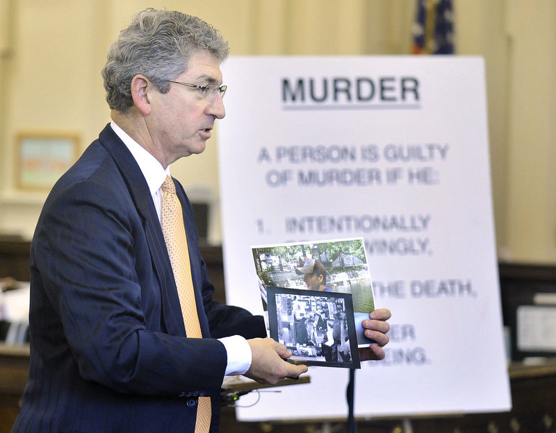 Prosecuting attorney William Stokes shows the jury video camera photos taken at a northern New Hampshire convenience store, allegedly of Jason Twardus, during the state's closing arguments Thursday.
