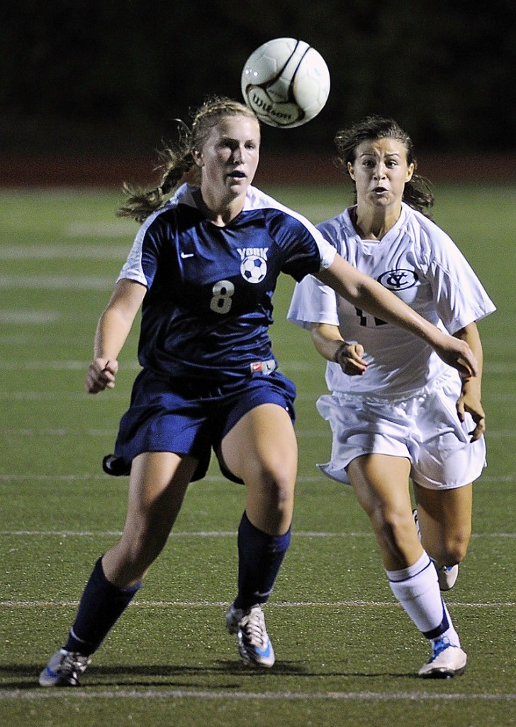 Caitlin Kelly of York attempts to knock the ball away from the charging Jeanna Lowery of Yarmouth near the York goal during the first half of Yarmouth's 1-0 victory Thursday night.