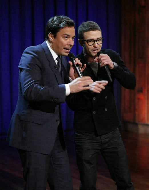 "Host Jimmy Fallon, left, performs with singer Justin Timberlake during ""Late Night with Jimmy Fallon"" on Wednesday night in New York."