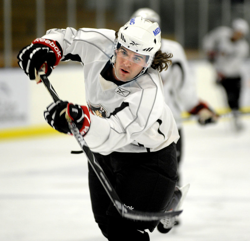 Dennis McCauley, who recently came to Portland from the Buffalo camp, takes a shot during practice Friday.