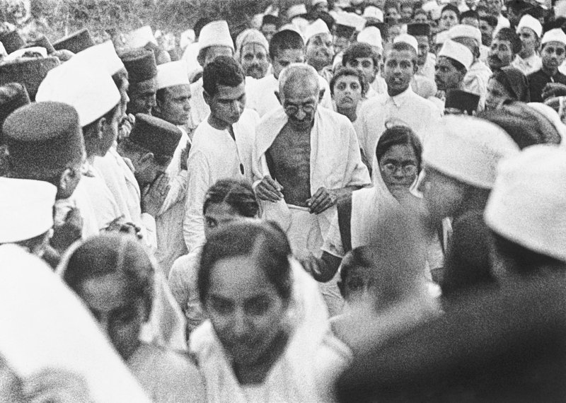 Mahatma Ghandi is surrounded by followers in India during his civil disobedience campaign in March 1930. Gandhi used nonviolent methods to overcome the oppression of Britain and win freedom for the Indian people.