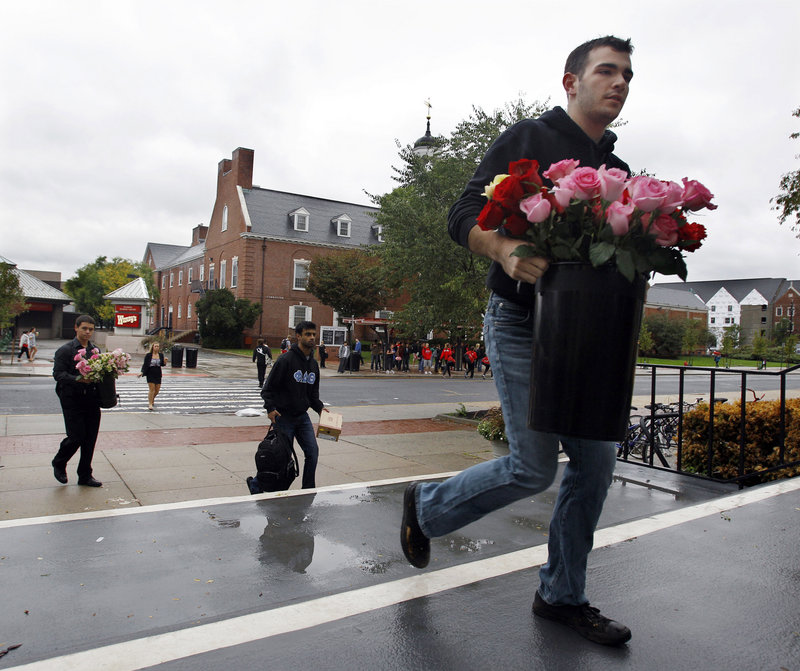 "Rutgers student Logan Gray heads to a service Friday for Tyler Clementi, who killed himself Sept. 22. The university plans to hold a vigil Sunday. ""Everyone is pretty devastated, and frankly, it's embarrassing that something like this would happen here at Rutgers,"" said student Jonathan Ramteke."