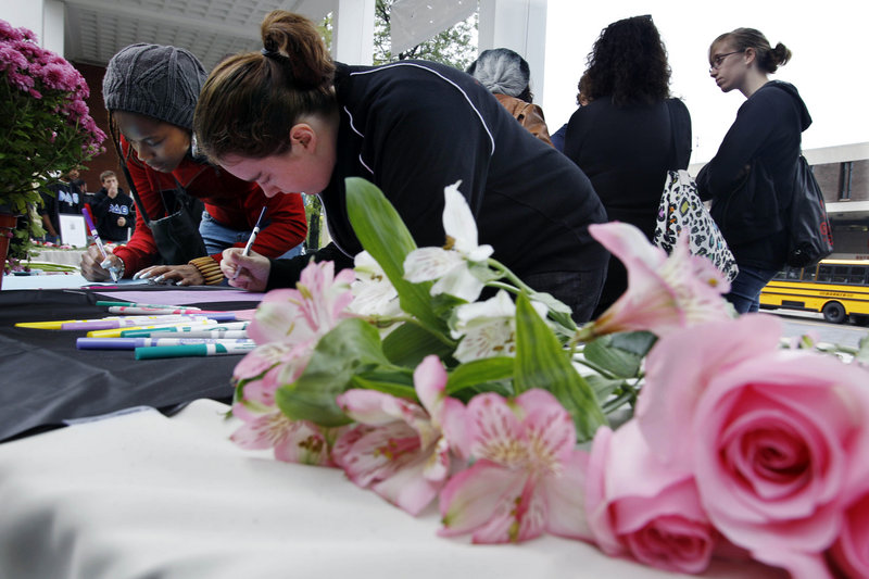 Students sign condolence cards for the family of Tyler Clementi on Friday at Rutgers University in New Brunswick, N.J. Clementi, 18, jumped off the George Washington Bridge after a secret video of his sexual encounter with a man was streamed online.