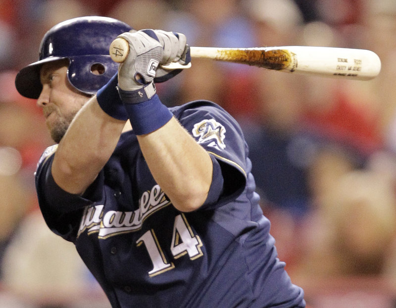Casey McGehee singles to drive in Corey Hart with the winning run in the 11th inning Friday night, leading the Brewers to a 4-3 victory over the Reds at Cincinnati. Starter Mark Rogers went five innings for Milwaukee.