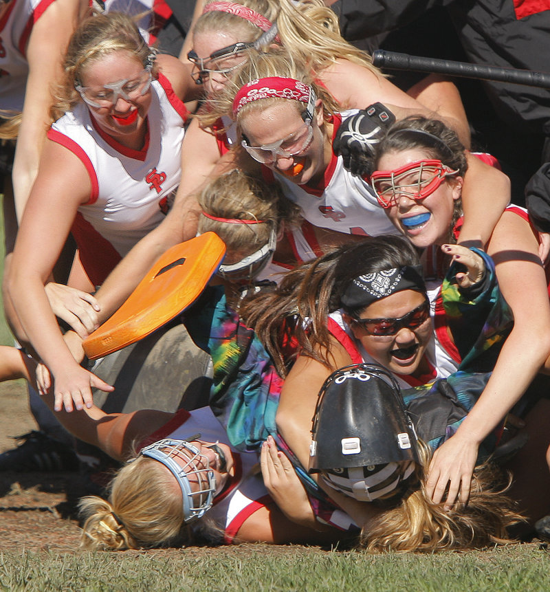 The South Portland field hockey players were a happy group Saturday, piling on top of goalie Lani Edwards after beating Scarborough 2-1 in a Southern Maine Activities Association game. Scarborough hadn't lost in two years.