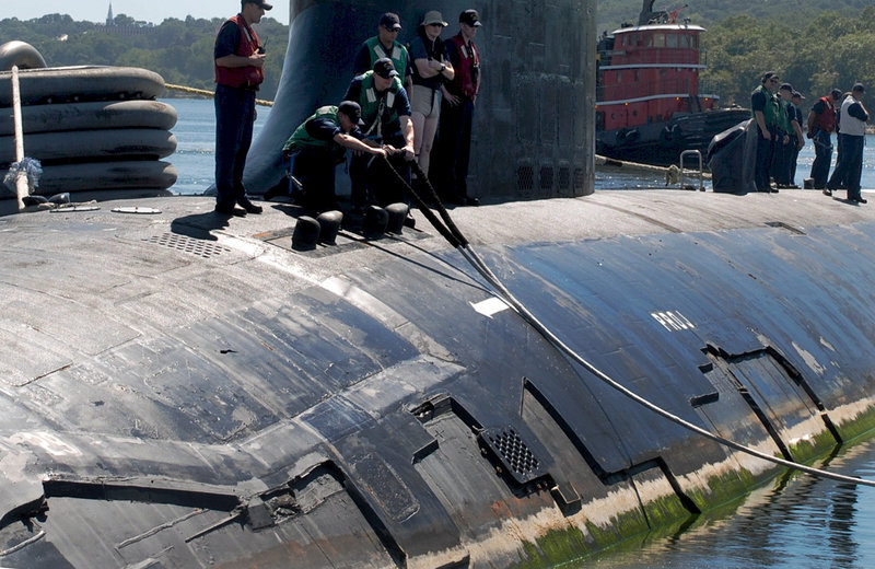 The USS Virginia departs the Naval Submarine Base New London in Groton, Conn., on Aug. 31 en route to Portsmouth Naval Shipyard in Kittery. The coating on its hull will be repaired during a regularly scheduled 14-month overhaul.