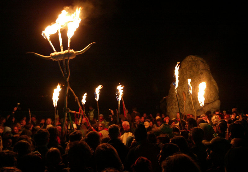 Druids perform rituals as part of the summer solstice ceremonies at Stonehenge, Wiltshire, England, before dawn. Druidry has been officially recognized as a religion in Britain.