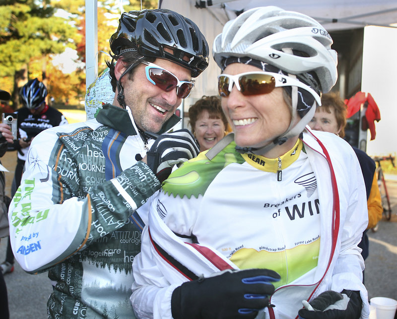 Actor Patrick Dempsey signs the jersey of participant Jody King of Buxton at the first rest stop for cyclists Sunday during the Dempsey Challenge, which raises funds for the Dempsey Center for Cancer Hope and Healing.