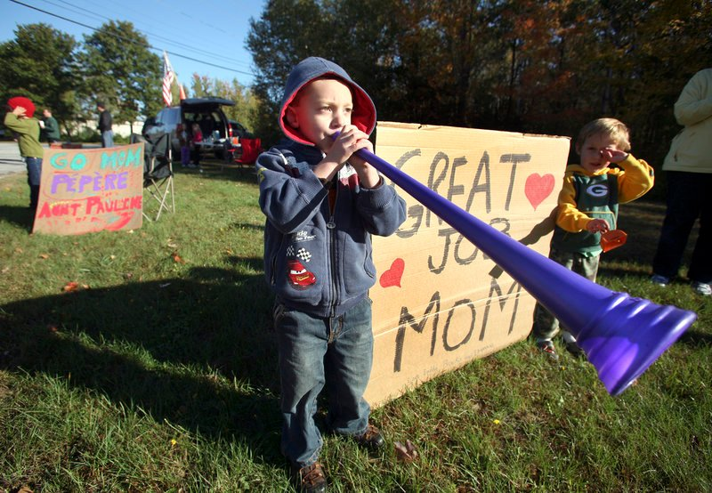 Ethan Boucher, 3, of Auburn blows a vuvuzela horn along the course to encourage the cyclists, including his father, Brian, during the Dempsey Challenge in Lewiston on Sunday.
