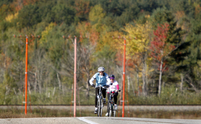 Two cyclists ride up a hill along Kitty Hawk Avenue in Lewiston. The Dempsey Challenge started with a 5K and 10K run and walk Saturday.