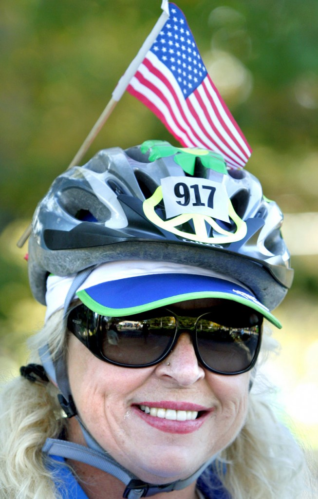Norma Boulet of Greene wears an American flag on her helmet in honor of her father, who was a World War II veteran. Boulet was riding the 25-mile course.