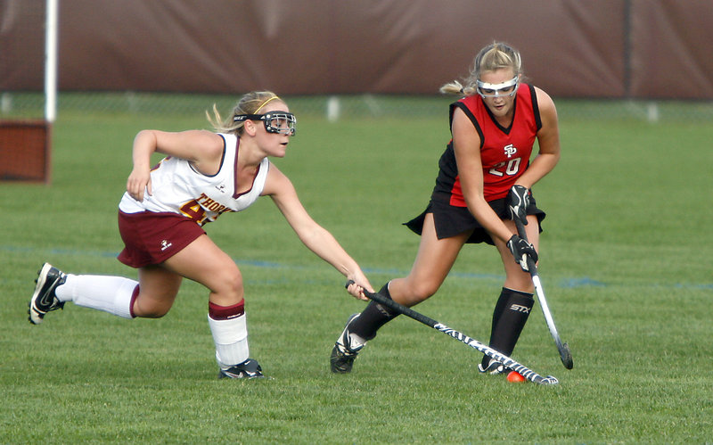 Breanna Thibodeau, left, of Thornton Academy attempts to steal the ball from South Portland's Olivia Edwards.