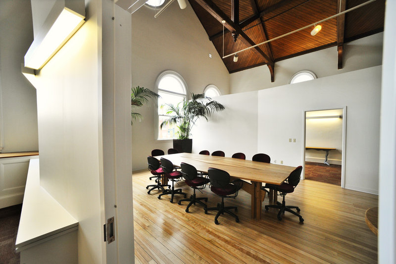 A conference space known as the Atrium takes advantage of the natural lighting provided by large windows on the third floor.