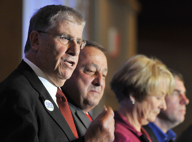 From left, Eliot Cutler makes a point as rival candidates for governor Paul LePage, Libby Mitchell and Shawn Moody stand by at Wednesday's Portland Regional Chamber breakfast. Kevin Scott also attended the debate at the Holiday Inn by the Bay.