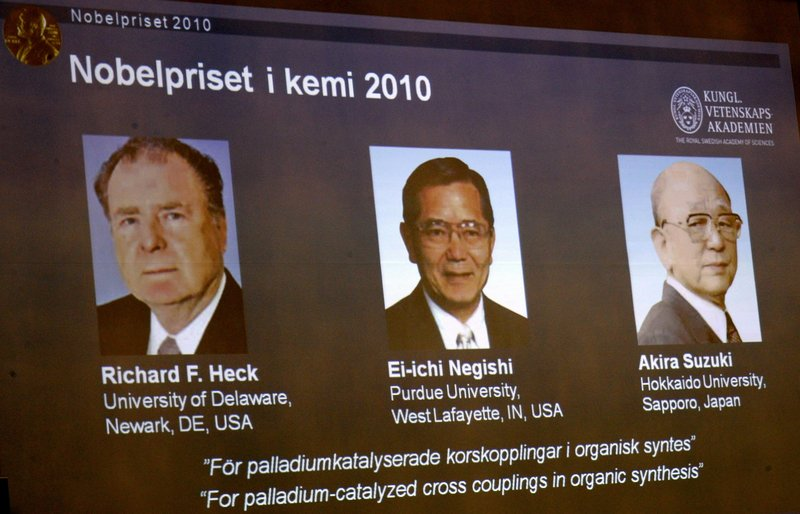 Portraits on an overhead screen in Stockholm, Sweden, show three researchers who won the 2010 Nobel Prize in chemistry on Wednesday. Their work has allowed scientists to make advances in medicine, agriculture and electronics.