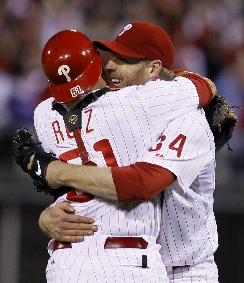 Roy Halladay celebrates with catcher Carlos Ruiz after throwing the second no-hitter in postseason history, a 4-0 win over Cincinnati.