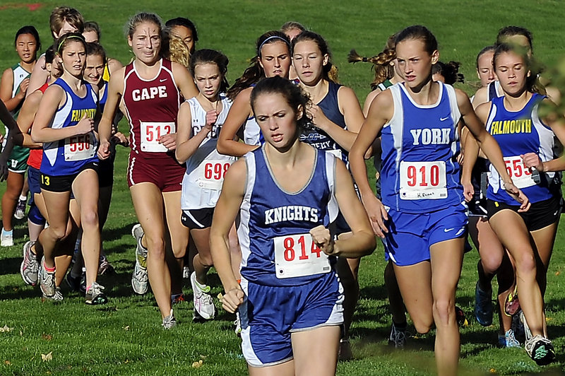 Kendra Lobley of Poland sets the early pace with eventual winner Heather Evans (910) of York close behind during the girls' race at the Western Maine Conference cross country meet Thursday at Falmouth. Lobley finished fifth, and Cape Elizabeth won the Division I title.