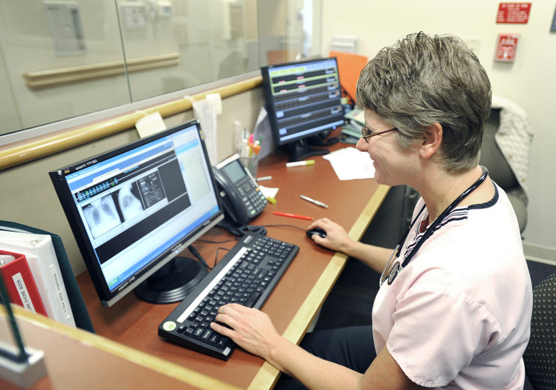 Marybeth Bubar, a nurse at Mid Coast Hospital in Brunswick, demonstrates the Internet speed the hospital gains from its connection to the first segment of the Three Ring Binder, a network that will link health care providers, campuses and other institutions across Maine.