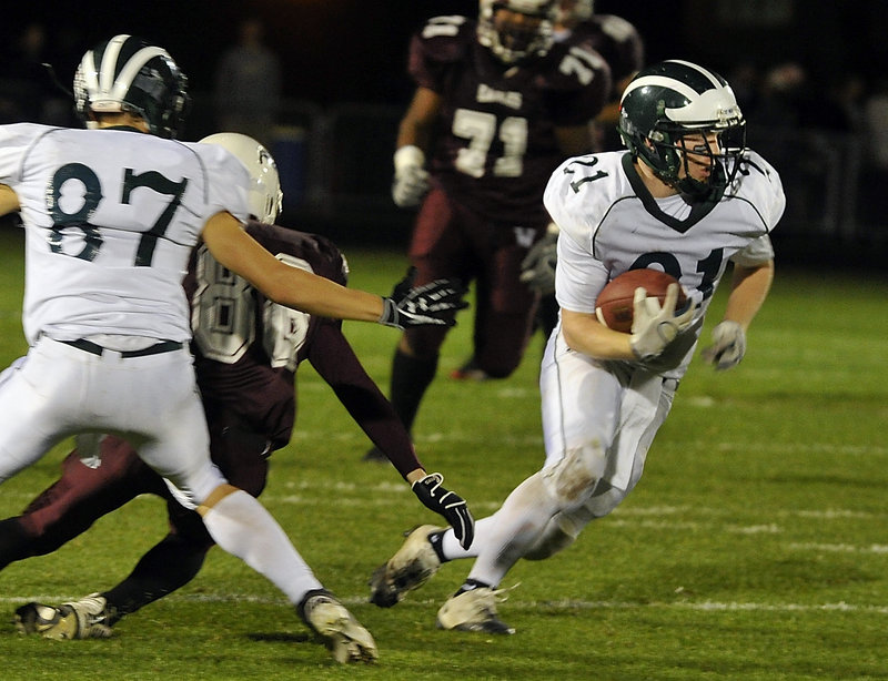 Nick Adkins of Windham gets help from Robert Plaza, left, and breaks into the open during Friday night's game at Windham. Adkins' 26-yard run set up the Scots' final touchdown in a 21-19 victory.