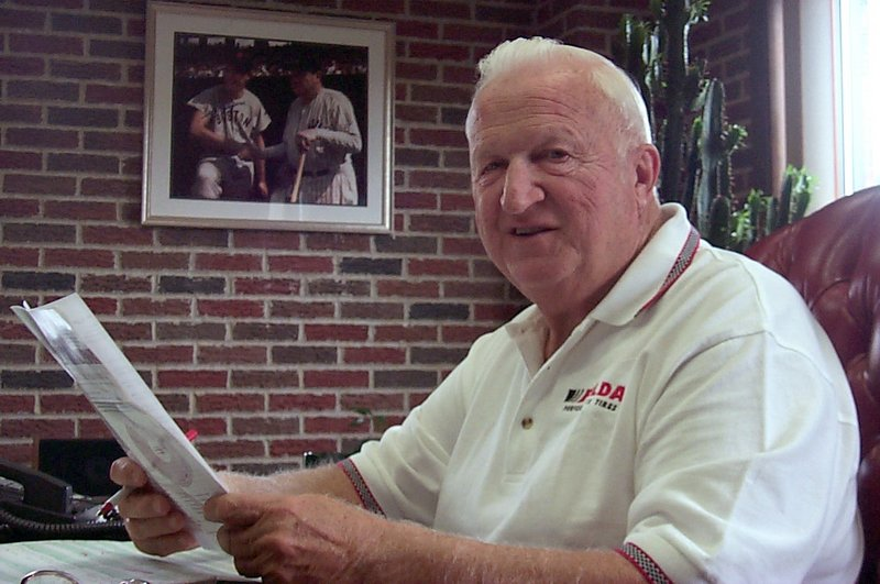 Thomas O. Auger, who died last week, is shown reviewing paperwork in the Lewiston office of his auto parts store, VIP Discount Auto Center, prior to the 2001 sale of the company.