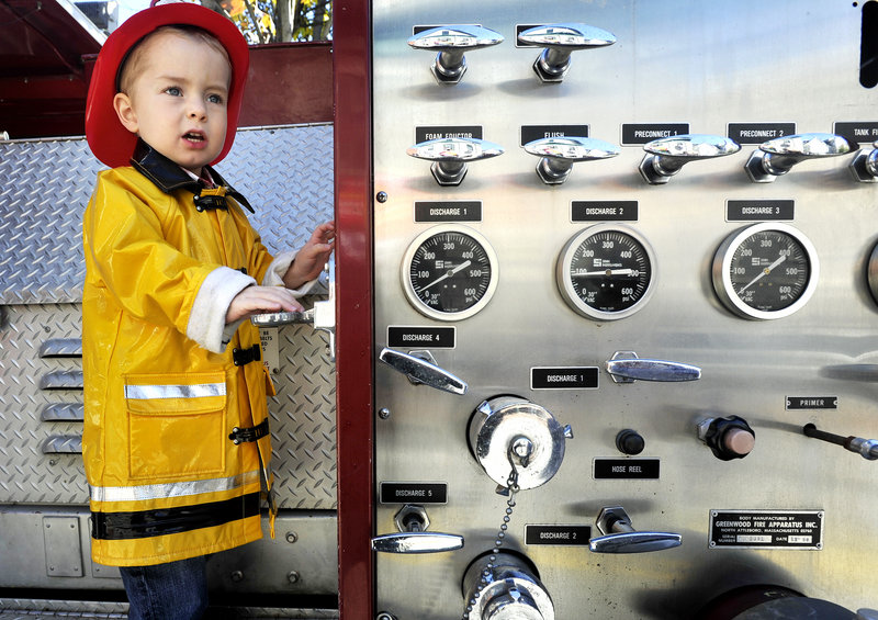 Noah Timmins, 3, of Portland came dressed for the occasion and got to climb aboard a fire truck.