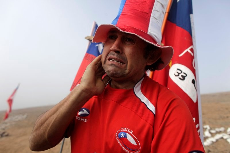 A man weeps after it was announced that a drill reached the 33 trapped miners at the San Jose Mine near Copiapo, Chile, on Saturday, after 33 days of drilling.