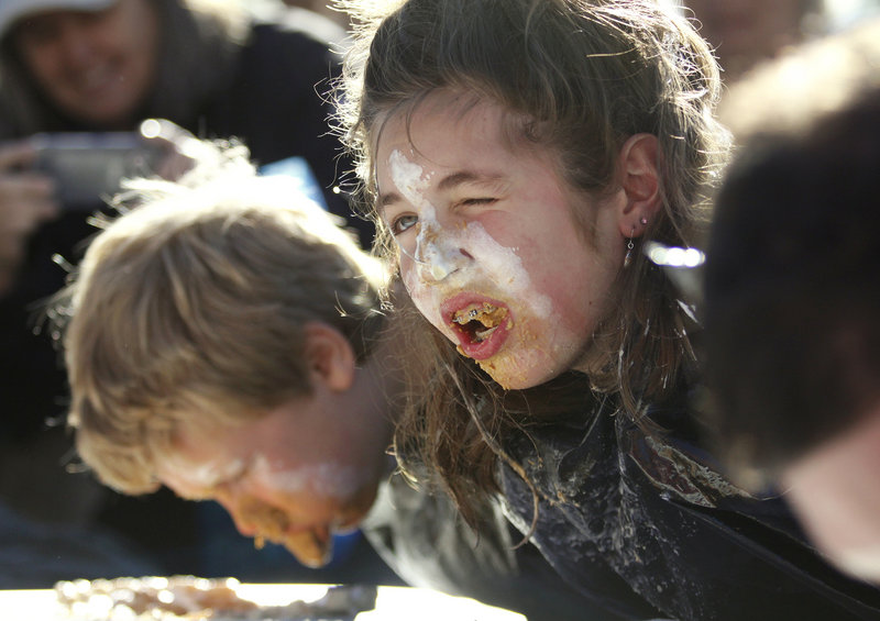 Brittany Marx, 13, of Fairfield takes a breather during the pumpkin pie eating contest on Saturday.