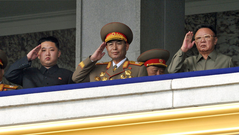North Korean leader Kim Jong Il, right, and his son Kim Jong Un, left, attend a military parade marking the 65th anniversary of the ruling Workers' Party on Sunday.