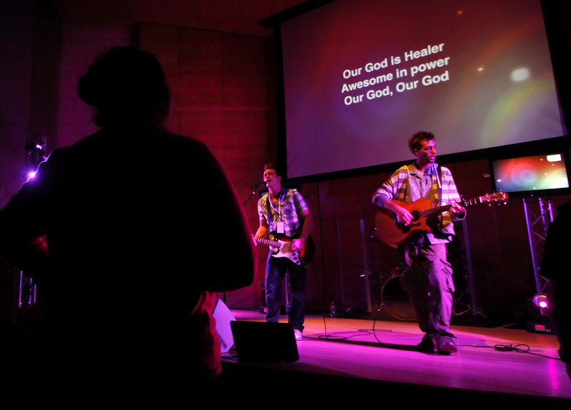 Devin Craig, left, and Jared Grant of the Next Level Church band perform Sunday.